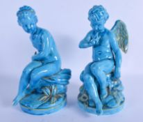 A PAIR OF 19TH CENTURY EUROPEAN BLUE GLAZED PUTTI Minton or Sevres. 24 cm high.