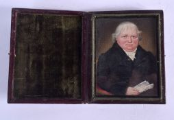 AN EARLY 19TH CENTURY EUROPEAN PAINTED IVORY PORTRAIT MINIATURE depicting a male holding a deed. Ivo