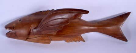A LARGE PITCAIRN ISLANDS FIGURE OF A FLYING FISH by Gifford Christian. 39 cm x 12 cm.
