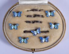 A CHARMING ART DECO SILVER AND ENAMEL BUTTERFLY BUTTON SET. 1 cm x 0.5 cm.