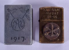 A MILITARY CHROME MATCHBOX HOLDER and another. Largest 6 cm x 4.5 cm. (2)