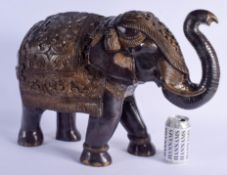 A LARGE INDIAN BRONZE FIGURE OF A STANDING ELEPHANT modelled in foliate embellished wares. 56 cm x 3