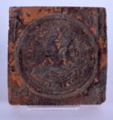 A 19TH CENTURY CONTINENTAL GRAND TOUR POTTERY TILE After the Antiquity. 9.5 cm square.