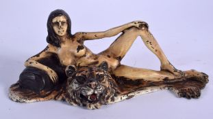 A CONTEMPORARY COLD PAINTED BRONZE NUDE LADY upon a tiger skin rug. 14 cm x 8 cm.