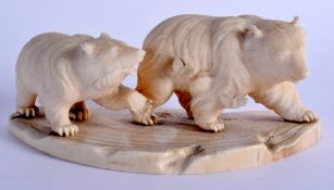 A 19TH CENTURY JAPANESE MEIJI PERIOD CARVED IVORY OKIMONO modelled as roaming bears. 14 cm x 6 cm.