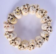 AN EARLY 20TH CENTURY JAPANESE MEIJI PERIOD CARVED BONE SKULL BRACELET. 8 cm wide.