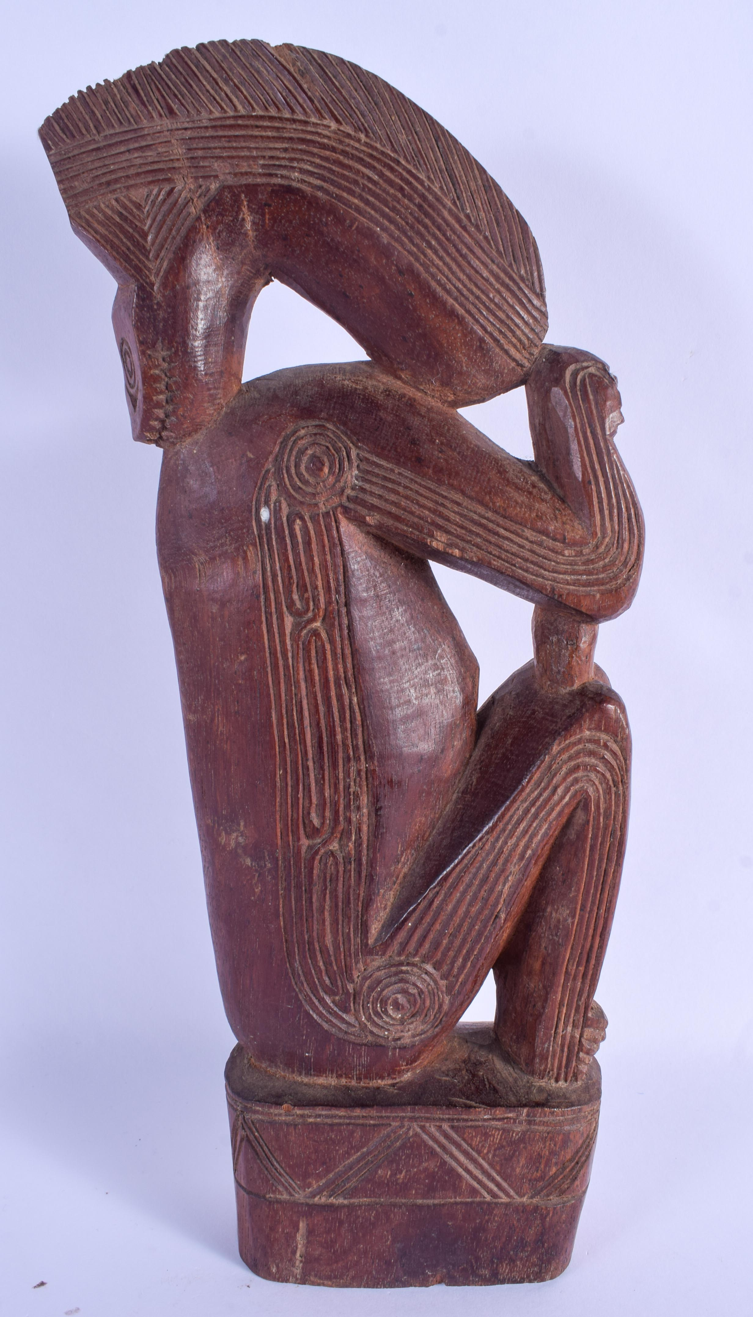 AN UNUSUAL TRIBAL CARVED HARDWOOD FIGURE OF AN ANIMAL possibly Papua New Guinea, Sepik 32 cm x 11 cm - Image 2 of 3