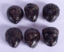 SIX UNUSUAL AFRICAN TRIBAL HEADS. 2 cm x 1 cm. (6)