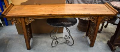A LARGE 19TH CENTURY CHINESE PROVINCIAL CARVED LIGHT ELM ALTAR TABLE modelled in the Ming style, for