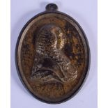 AN 18TH CENTURY CONTINENTAL GILDED IRON PLAQUE OF A MALE depicting a gentleman. 9 cm x 11.5 cm.