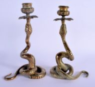 A PAIR OF 19TH CENTURY CONTINENTAL BRONZE SERPENT CANDLESTICKS possibly Indian. 23.5 cm high.