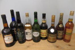 9 various liqueurs and spirits comprising 1 litre and 1 bottle Harvey's Bristol Cream, 1 bottle