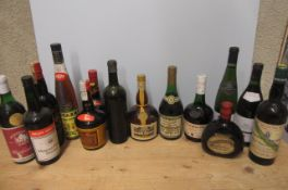 A large quantity of liqueur and French wine, including 1 litre Grand Marnier, 1 bottle Napoleon