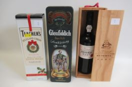 1 bottle of Glenfiddich Pure Malt whisky, in a Clan Macpherson tin, together with Teacher's Highland