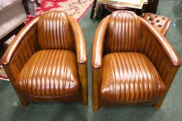 A PAIR OF AVIATOR CLUB ARMCHAIRS, with leather seats in a wooden frame, with ebonised fluted
