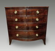 A VERY FINE GEORGIAN FIGURED MAHOGANY BOW FRONTED CHEST OF DRAWERS, circa 1800, with crossbanded and