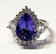 AN EXQUISITE 18CT WHITE TANZAINTE & DIAMOND CLUSTER RING, the Tanzanite is a great example of this