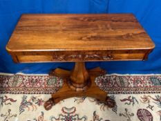 A FINE WILLIAM IV ROSEWOOD FOLD OVER CARD TABLE with cross banded edge, curved front corners, carved