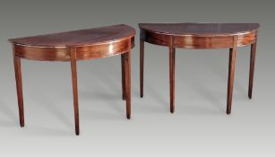 A PAIR OF GOOD QUALITY GEORGIAN 18TH CENTURY MAHOGANY DEMI LUNE TABLES, circa 1780, raised on reeded