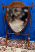 A VERY FINE MAHOGANY INLAID MIRROR GLAZED FIRE SCREEN, heart shaped raised on turned supports 20 x