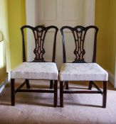 A PAIR OF WELL CARVED CHIPPENDALE SIDE CHAIRS, with acanthus leaf draped shoulders and rest rail,