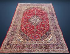 A PERSIAN KASHAN RUG, Kashan Iran, c.1980, hand woven by a master weaver over six months on an