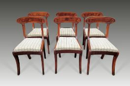 A VERY FINE SET OF SIX REGENCY MAHOGANY DINING CHAIRS, circa 1820, having carved rest rails, with