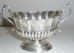A LATE 19TH CENTURY TWO HANDLED SILVER CENTRE BOWL, Birmingham, 1894, with scalloped rim and half