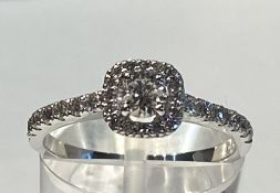 AN 18CT WHITE GOLD DIAMOND HALO RING, with centre diamond .60cts, total diamond weight 1.10cts,