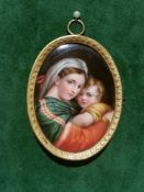 A 19TH CENTURY MINIATURE PORCELAIN PANEL, After Raphael, Madonna della Sedia, framed in a decorative