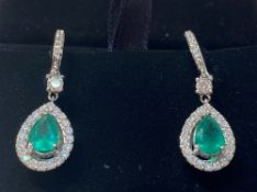 A STUNNING PAIR OF 18CT WHITE GOLD COLUMBIAN EMERALD & DIAMOND DROP EARRINGS, with two pear shaped
