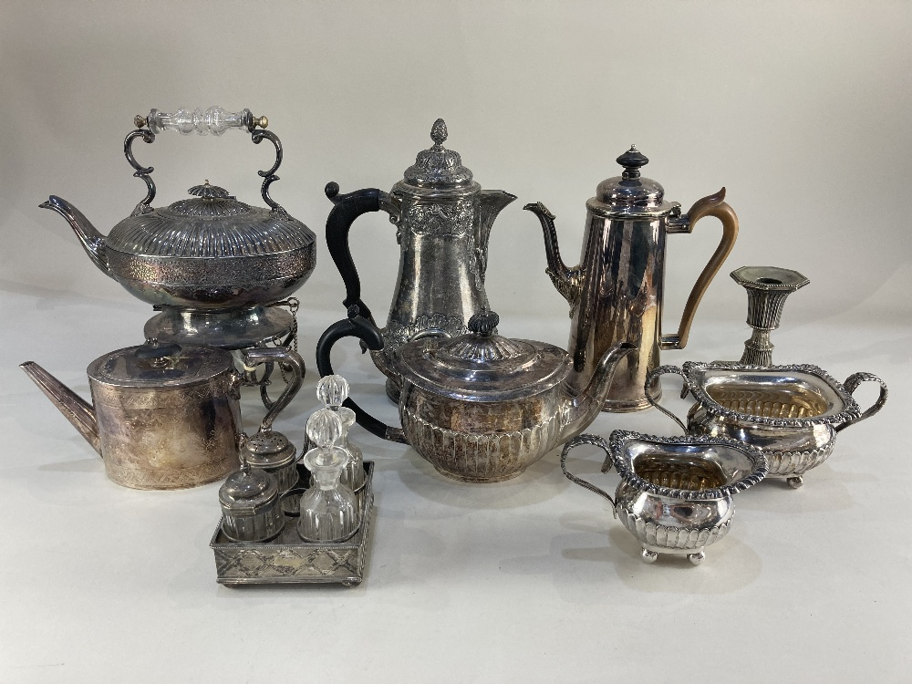 Lot 602 - A Mappin & Webb silver plated teapot, a silver plated kettle on stand with burner, a hot water