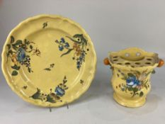 A late 18th century tin glazed faience Moustiers plate, decorated in the Montpellier style with