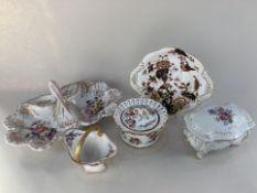 A Berlin KPM porcelain entree dish, a Limoges sugar basket and JL Menau porcelain box and cover, all