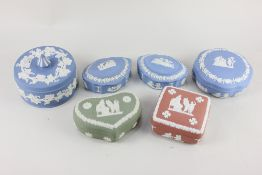A collection of six Wedgwood Jasperware lidded trinket pots, assorted shapes and colour ways,