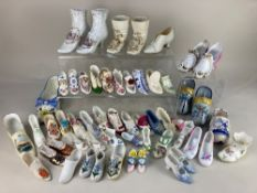A very large collection of porcelain and glass model shoes, makers including Masons, Hammersley,