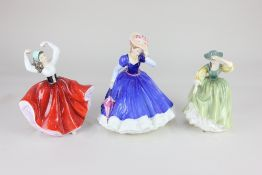 Five Royal Doulton porcelain figures of ladies, comprising 'Figure of the Year 1992 Mary', '