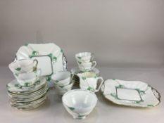 An Art Deco Fenton porcelain part tea service, comprising two cake plates, six cups, twelve saucers,
