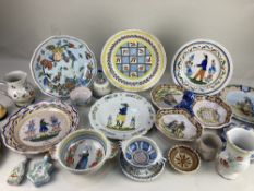 A collection of 19th and 20th century Quimper pottery, including plates decorated with men