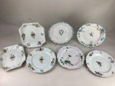Four 18th century faience plates, two with polychrome floral design, two with green floral and