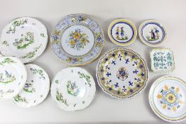 A collection of French and Italian faience pottery plates and dishes, to include pair of Henriot
