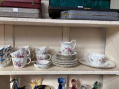 A Royal Crown Derby porcelain part tea set in the Derby Posies pattern, a Grosvenor porcelain part