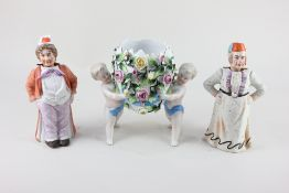 A Dresden style porcelain bowl formed as two cherubs carrying an egg, with floral encrusted