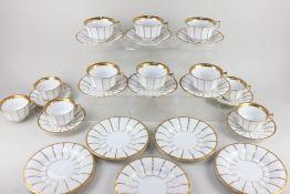 A Royal Copenhagen porcelain part tea set, decorated with gilt stripes on white ground, comprising