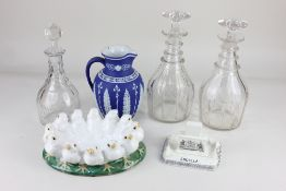 A 'Jasperware' blue and white porcelain jug, with foliate decoration (a/f), and three glass