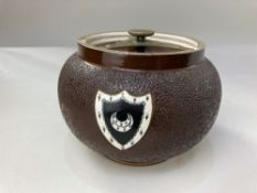 A Bacon Brothers, Cambidge pottery tobacco jar and cover, with crescent moon shield on brown