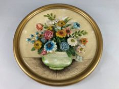 A 20th century chalk ware floral relief wall plaque, stamped FL Copyright No. 21, 38cm diameter