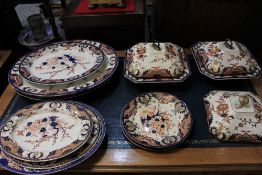 An 18th century and later Derby porcelain part dinner service, decorated in the Imari palette,
