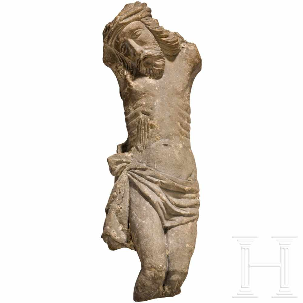 Lot 57 - A late Gothic stone sculpture of Christ on the cross, Bamberg, 14th - 15th centuryExpressive