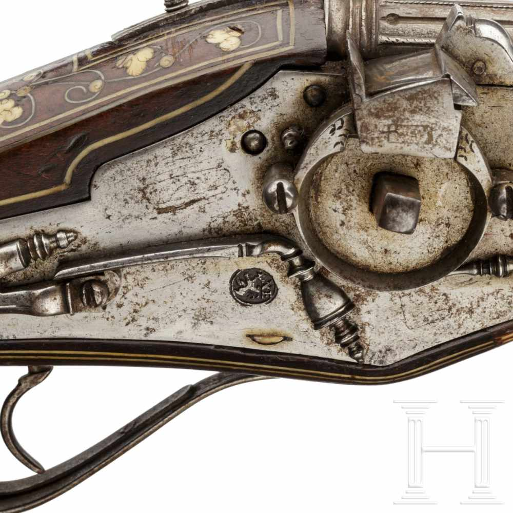 Lot 2012 - A pair of bone-inlaid, extremely long wheellock pistols, Nuremberg, circa 1600The long, round,